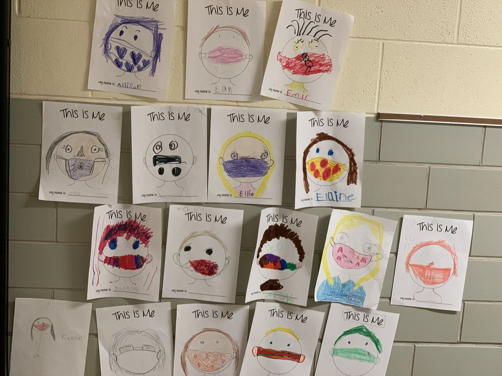 First grade self portraits with masks.